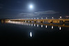 The Tay Bridge under a clear full moon.